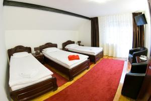 Dormitor cu 2+1 paturi